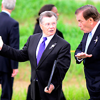 """Jim Miklaszewski, NBC News Correspondent and Tom Ridge, former United States Secretary, Department of Homeland Security walk to the """"Wall of Names"""" at the crash site of Flight 93 after the ceremony at the Flight 93 National Memorial on the 14th Observance of Flight 93 crash and terrorist attacks on America near Shanksville, Pennsylvania on September 11, 2015.  Photo by Archie Carpenter/UPI"""