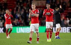 Middlesbrough's George Saville (centre) and Ashley Fletcher (right) applaud the fans at the end of the Carabao Cup, Fourth Round match at the Riverside Stadium, Middlesbrough.