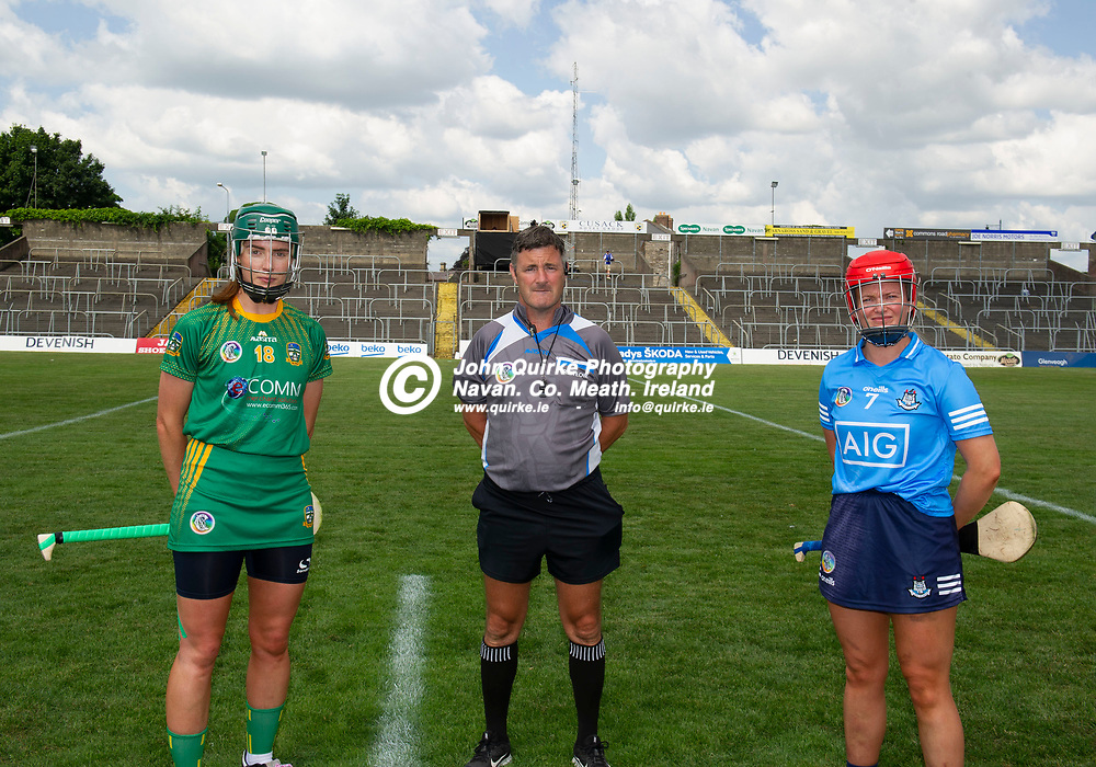 25-07-21. Meath v Dublin All-Ireland Intermediate Camogie Championship (Group 1) at Pairc Tailteann, Navan.<br /> Meath captain Kristina Troy and Dublin captain Ciara Buchanan pictured with referee Alan Doheny, Laois.<br /> Photo: John Quirke / www.quirke.ie<br /> ©John Quirke Photography, 16 Proudstown Road, Navan. Co. Meath. (info@quirke.ie / 046-9028461 / 087-2579454).
