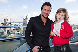 © Licensed to London News Pictures. 26/01/2012. London, England. Peter Andre with Scarlett Kavenagh, 5, from Walker Primary School in Enfield. Today, 26 January, popstar and children's author Peter Andre presented twenty London school children with awards at City Hall for winning stories they have written about where they live, part of the Mayor of London's drive to improve literacy. The competition was also part of the Big WoW (Walk once a Week). Photo credit: Bettina Strenske/LNP