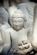 Newly carved buddha statues at a market in Mandalay, Myanmar