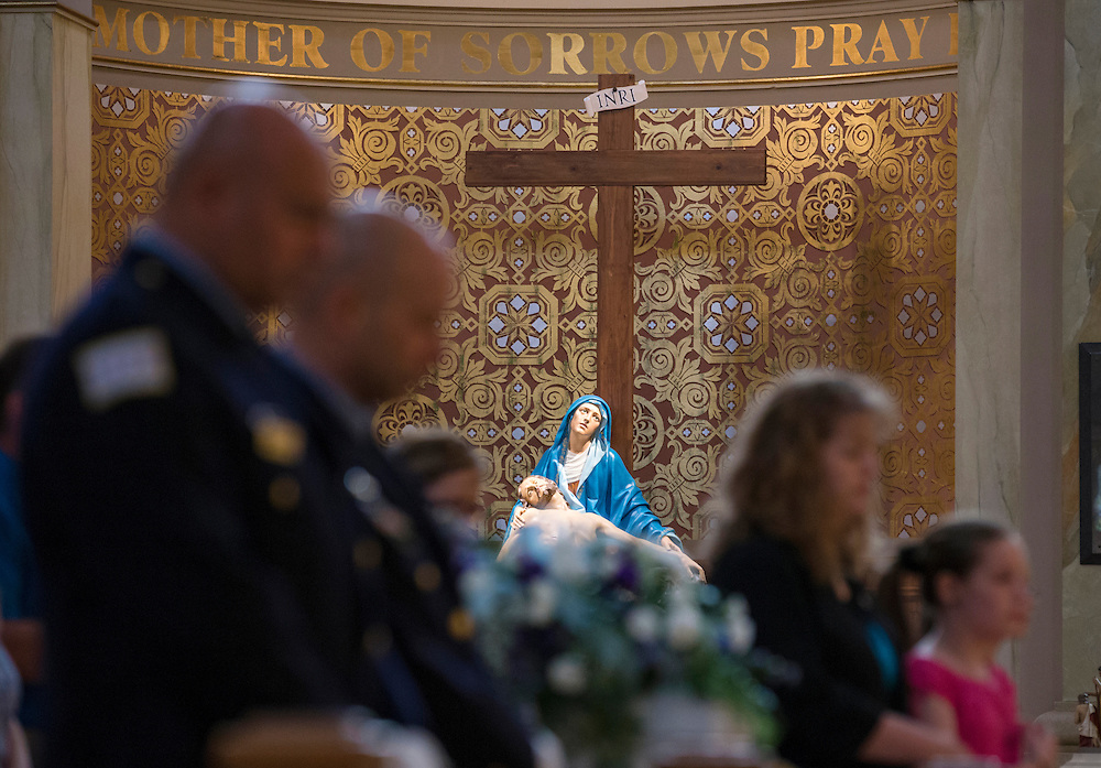 """Mourners attend the funeral mass for an abandoned newborn baby boy at St. Hyacinth Basilica in Chicago, Illinois, United States, June 19, 2015. Picture taken June 19, 2015. More than a year after he was found dead in a plastic shopping bag on a Chicago sidewalk, the baby boy was buried by a non-profit group """"Rest in His Arms"""" after being abandoned by his teenage mother, who is charged with murder.   REUTERS/Jim Young"""