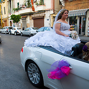 BEIRUT,LEBANON - JUNE 2009 :  Sarine  dressed as bride  going to her wedding in a convertible  at  the  Christian  quarter of Gemmayzeh .Beirut.Lebanon. 06/13/2009 ( Photo by Jordi Cami )