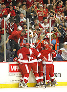 Lowell, MA 03/10/2010<br /> Hingham #16 Rick Boyle (facing) celebrates with his team after scoring the winning goal in overtime to defeat Malden Catholic in the MIAA Super Eight hockey semifinals on Wednesday night in Lowell.