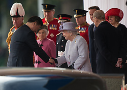 © London News Pictures 20/10/2015. Her Majesty The Queen and The President of The People's Republic of China<br /> <br /> More than 1,100 soldiers and 230 horses joined HM The Queen, HRH The Duke of Edinburgh, The Duke and Duchess of Cornwall, the Prime Minister, Senior members of the Cabinet, the Lord Mayor of London, the Mayor of London, and the Defence Chiefs of Staff for the ceremonial welcome to Britain of The President of The People's Republic of China and Madame Peng Liyuan . Photo credit: Rupert Frere/LNP
