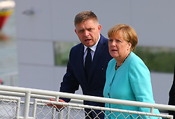 BRATISLAVA, Sept. 17, 2016 (Xinhua) -- German Chancellor Angela Merkel (R) and Slovak Prime Minister Robert Fico arrive at a wharf by the Danube river on the sidelines of an informal European Union (EU) summit in Bratislava, Slovakia, Sept. 16, 2016. EU members on Friday issued a joint declaration, formulating a road map for the bloc to tackle challenges, said Slovak Prime Minister Robert Fico. (Xinhua/Gong Bing) (wtc) (Credit Image: © Gong Bing/Xinhua via ZUMA Wire)