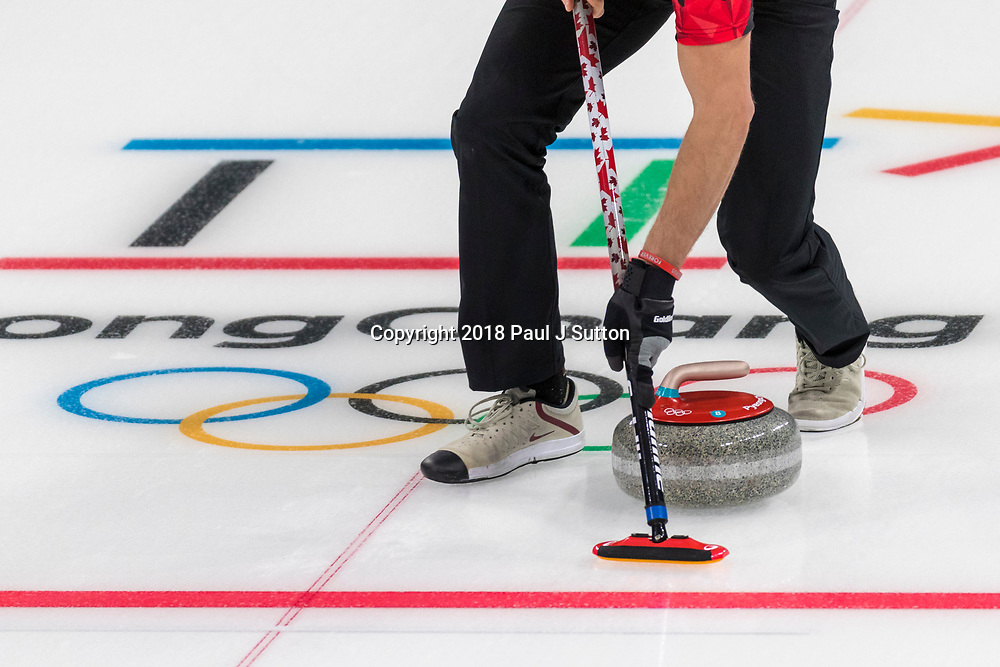 Detail of curling broom and stone at the Olympic Winter Games PyeongChang 2018