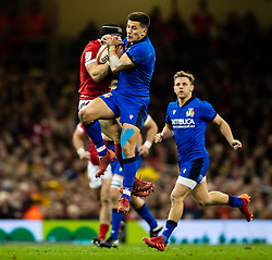 Tommaso Allan of Italy vies for the high ball with Leigh Halfpenny of Wales<br /> <br /> Photographer Simon King/Replay Images<br /> <br /> Six Nations Round 1 - Wales v Italy - Saturday 1st February 2020 - Principality Stadium - Cardiff<br /> <br /> World Copyright © Replay Images . All rights reserved. info@replayimages.co.uk - http://replayimages.co.uk