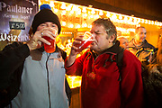 Men enjoying drinking beer from a German Christmas market stall. The South Bank is a significant arts and entertainment district, and home to an endless list of activities for Londoners, visitors and tourists alike.