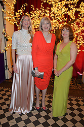 Left to right, LADY JUBIE WIGAN, the Home Secretary THERESA MAY MP and KAREN ADDINGTON CEO of JDRFat the Sugarplum Dinner - The event was for the launch of Sugarplum Children, a new website and fundraising initiative for children who live with type 1 diabetes, and to raise money for JDRF (Juvenile Diabetes Research Foundation) held at One Mayfair, 13A North Audley Street, London on 20th November 2013.