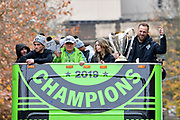 Seattle Sounders goalkeeper Stefan Frei, right, hold the MLS Cup trophy as he rides with teammates, including midfielder and captain Nicolas Lodeiro, left, during the MLS Cup Champions Parade & Rally on November 12, 2019 in Seattle, Washington, to celebrate the Sounders' win over Toronto FC to win the MLS Cup soccer match in Seattle. (Alika Jenner/Image of Sport)
