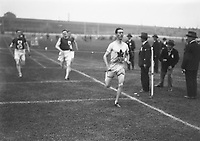 H893<br /> Aonach Tailteann Athletics - Croke Park. 1928. J. Ball Canada winning the 400 meter race with Sean lavin, Ireland second. (Part of the Independent Newspapers Ireland/NLI Collection)
