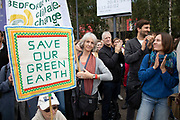 Supporters and protesters listen to speeches and hold up their banners and placards at the Rise For Climate Change event held outside Tate Modern in London, England, United Kingdom on September 8th 2018. Tens of thousands of people joined over 830 actions in 91 countries under the banner of Rise for Climate to demonstrate the urgency of the climate crisis. Communities around the world shined a spotlight on the increasing impacts they are experiencing and demanded local action to keep fossil fuels in the ground. There were hundreds of creative events and actions that challenged fossil fuels and called for a swift and just transition to 100% renewable energy for all. Event organizers emphasized community-led solutions, starting in places most impacted by pollution and climate change. Photographed for 350.org.