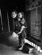 Child with baby on back in home