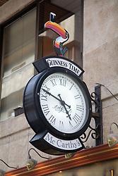 Clock outside an Irish Pub in Las Palmas; Canaries,
