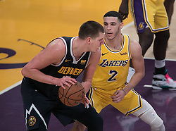 October 25, 2018 - Los Angeles, California, U.S - Nikola Jokic #15 of the Denver Nuggets tries to get past Lonzo Ball #2 of the Los Angeles Lakers  during their NBA game on Thursday October 25, 2018 at the Staples Center in Los Angeles, California. Lakers defeat Nuggets, 121-114. (Credit Image: © Prensa Internacional via ZUMA Wire)