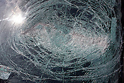 A detail of a smashed car windscreen, damaged by a collision.