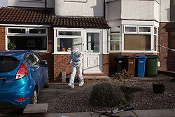 © Licensed to London News Pictures . 17/01/2015 . Stockport , UK . A forensic scenes of crime examiner leaves  28 Meadway Road , Cheadle Hulme , Stockport this afternoon (Saturday 17th January 2015 ) after a man and a woman in their 40s were found dead inside last night (16th January 2015) . Photo credit : Joel Goodman/LNP