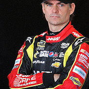 NASCAR Sprint Cup driver Jeff Gordon stands in the garage area, during a NASCAR Daytona 500 practice session at Daytona International Speedway on Wednesday, February 20, 2013 in Daytona Beach, Florida.  (AP Photo/Alex Menendez)