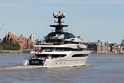 © Licensed to London News Pictures. 03/10/2016. LONDON, UK.  Superyacht, Kismet leaves London on the River Thames during blue skies and sunny autumn weather this lunchtime, after mooring at Butlers Wharf last week. Kismet is 308 feet long and is reportedly owned by Pakistani-American billionaire Shahid Khan, who owns the National Football League (NFL) team, the Jacksonville Jaguars, who played the Colts in an International Series game at Wembley yesterday. Kismet has 6 staterooms, with the master bedroom having its own private deck with jacuzzi and helipad and can be chartered for an estimated £1m per week. Photo credit: Vickie Flores/LNP