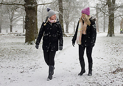 © Licensed to London News Pictures. 24/01/2021. London, UK. People take a Sunday walk in the snowy conditions in Bushy Park, south west London. A band of snow is crossing the south east this morning as temperature remain just above freezing. Photo credit: Peter Macdiarmid/LNP