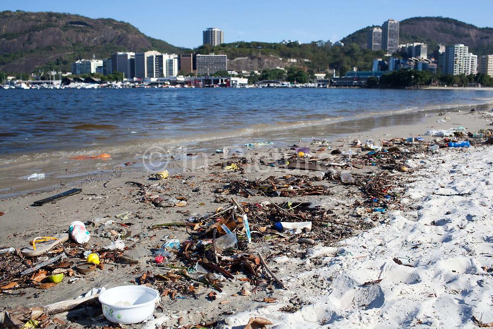 Rubbish litter pollution on Botafogo beach near the marina, Rio de Janeiro, Brazil.