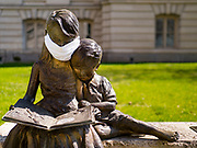 """04 APRIL 2020 - DES MOINES, IOWA: Somebody put a mask on a statue in front of the courthouse in Des Moines. On Saturday morning, 04 April, Iowa reported 786 confirmed cases of the Novel Coronavirus (SARS-CoV-2) and COVID-19. There have been 14 deaths attributed to COVID-19 in Iowa. Restaurants, bars, movie theaters, places that draw crowds are closed until 30 April. The Governor has not ordered """"shelter in place"""" but several Mayors, including the Mayor of Des Moines, have asked residents to stay in their homes for all but the essential needs. People are being encouraged to practice """"social distancing"""" and many businesses are requiring or encouraging employees to telecommute.        PHOTO BY JACK KURTZ"""