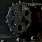 Large gears in old industrial plant.