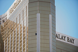 The shattered window is seen at the Mandalay Bay hotel-casino where a gunman fired on a crowd of concert goers the night before from Las Vegas, Nev., on Monday, October 2, 2017. Martin S. Fuentes for Zuma Press.