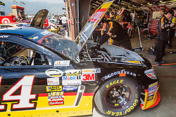 Fontana, CA/USA (Saturday, March 23, 2013) -  NASCAR Sprint Cup Series Driver Tony Stewart car is taking care of at his garage after practice at the Auto Club Speedway in Fontana, CA   PHOTO © Eduardo E. Silva/SILVEX.PHOTOSHELTER.COM.