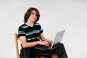 Young college Teen boy with a laptop computer