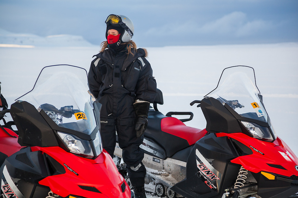 UNIS student Sofie Vej Ugelvig stands by her snowmobile in Sassendalen, Svalbard on a class field trip to Tunabreen.