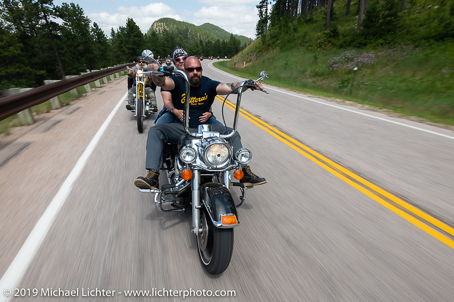 Buttera's Metal Werx' Tina and Brian Buttera on the Cycle Source Ride up Vanocker Canyon to Nemo during the Sturgis Black Hills Motorcycle Rally. SD, USA. Wednesday, August 7, 2019. Photography ©2019 Michael Lichter.