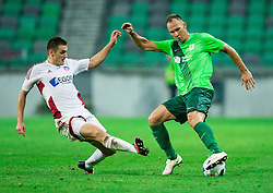 Matus Bero of AS Trencin vs Dejan Kelhar of NK Olimpija during 1st Leg football match between NK Olimpija Ljubljana (SLO) and FK AS Trenčin (SVK) in Second Qualifying Round of UEFA Champions League 2016/17, on July 13, 2016 in SRC Stozice, Ljubljana, Slovenia. Photo by Vid Ponikvar / Sportida