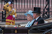 """The Queen and Prince Philip - Trooping the Colour by the Irish Guards on the Queen's Birthday Parade. The Queen's Colour is """"Trooped"""" in front of Her Majesty The Queen and all the Royal Colonels.  His Royal Highness The Duke of Cambridge takes the Colonel's Review for the first time on Horse Guards Parade riding his horse Wellesley. The Irish Guards are led out by their famous wolfhound mascot Domhnall and more than one thousand Household Division soldiers perform their ceremonial duty. The Soldiers will parade in the traditional ceremonial uniforms of the Household Cavalry, Royal Horse Artillery, and Foot Guards. They are accompanied by the Household Division Bands & Corps of Drums. London 17th June 2017."""