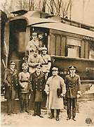 Photograph taken 11 November 1918 as Marshal Foche, second from right, leaves the railway carriage in which the  Armistice  which ended the First World War. He is carrying the text of the agreement signed  by Germany and by Foche on behalf of the Allies.