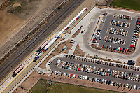 The parking lot and Frontrunner Station with the train stopping