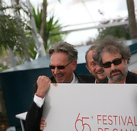 Director Gustave Kervern, Actor Benoît Poelvoorde, Director Benoît Delepine dismantle the podium at Le Grand Soir photocall at the 65th Cannes Film Festival France. Tuesday 22nd May 2012 in Cannes Film Festival, France.