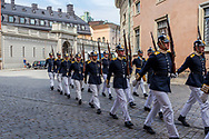 Stockholm, Sweden -- July 18, 2019. Swedish soldiers march through Stockholm to the Royal Palace for the changing of the guard.