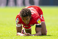 Barnsley forward Jacob Brown (7) on the ground following a challenge, Barnsley goalkeeper Jack Walton (13) protests to the referee in the background, during the EFL Sky Bet Championship match between Queens Park Rangers and Barnsley at the Kiyan Prince Foundation Stadium, London, England on 20 June 2020.