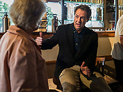 12 SEPTEMBER 2019 - CLIVE, IOWA: Governor STEVE BULLOCK (D-MT), right, talks to CHRISTIE VILSACK, wife of former Iowa Gov. Tom VilsackGov. Bullock is vying to be the Democratic party's nominee in 2020. He is campaigning in Iowa this week because he didn't qualify for the September 12 debate. Iowa traditionally hosts the the first election event of the presidential election cycle. The Iowa Caucuses will be on Feb. 3, 2020.              PHOTO BY JACK KURTZ