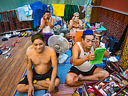 "30 JANUARY 2016 - NONTHABURI, NONTHABURI, THAILAND:  Male performers put on their makeup before a ""likay"" show at Wat Bua Khwan in Nonthaburi, north of Bangkok. Likay is a form of popular folk theatre that includes exposition, singing and dancing in Thailand. It uses a combination of extravagant costumes and minimally equipped stages. Intentionally vague storylines means performances rely on actors' skills of improvisation. Like better the known Chinese Opera, which it resembles, Likay is performed mostly at temple fairs and privately sponsored events, especially in rural areas. Likay operas are televised and there is a market for bootleg likay videos and live performance of likay is becoming more rare.    PHOTO BY JACK KURTZ"