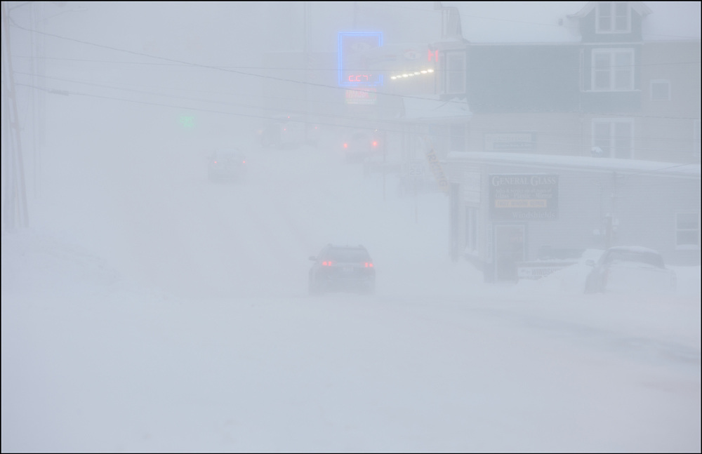Blizzard conditions have visibility down to less then a quarter mile in Hancock, Michigan.