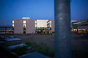 An exterior dusk view of the Heathrow terminal 5 hotel Sofitel showing wasteground still to be developed.