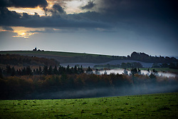 © Licensed to London News Pictures. 04/11/2019. Chichester, UK. The sun rises over the south Downs near Chichester as mist remains in places. Low pressure over the UK is bringing continued rain showers. Photo credit: Peter Macdiarmid/LNP