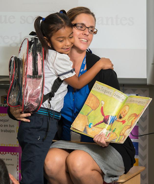 Estefania Espindola Garcia works with her 1st-grade class at Cunningham Elementary School, August 28, 2014.
