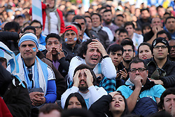June 26, 2018 - Buenos Aires, Argentina - Argentina soccer fans react as they watch a live telecast of their team's World Cup match against Nigeria in Buenos Aires. The match ended in Argentina 2 - Nigeria 1. (Credit Image: © Claudio Santisteban via ZUMA Wire)