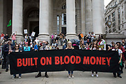 Environmental activists from Extinction Rebellion assemble behind a banner for a Blood Money March through the City of London on the fifth day of Impossible Rebellion protests on 27th August 2021 in London, United Kingdom. Extinction Rebellion were intending to highlight financial institutions funding fossil fuel projects, especially in the Global South, as well as law firms and institutions which facilitate them, whilst calling on the UK government to cease all new fossil fuel investment with immediate effect.