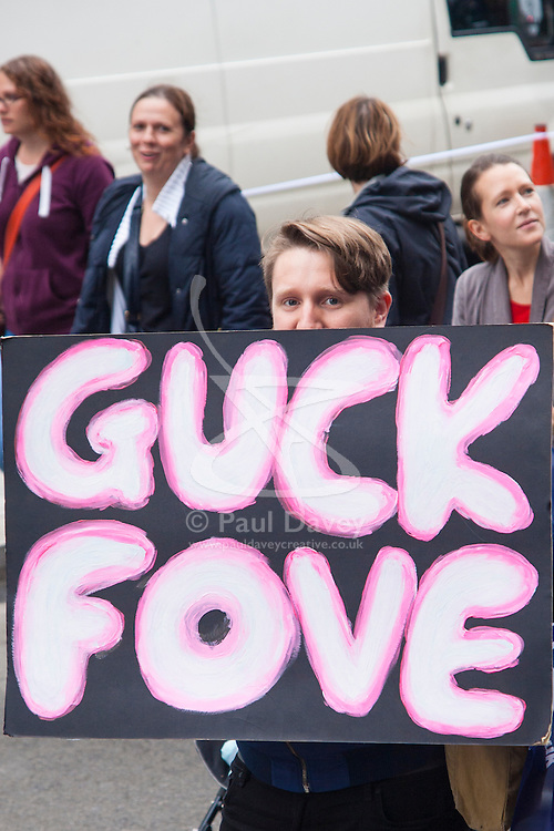 London, July 10th 2014. A protester's direct message for Education Secretary Michael Gove as thousands of striking teachers, government workers and firefighters march through London in protest against cuts and working conditions.