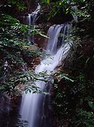 Sungai Pisang Waterfall in tropical rain forest at Alang Sedayu north of Kuala Lumpur, Malaysia.